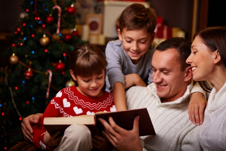 a-happy-family-reading-a-christmas-story-on-the-couch